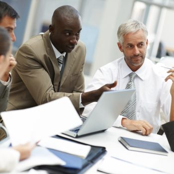 Photo of a creative business team busy at a meeting