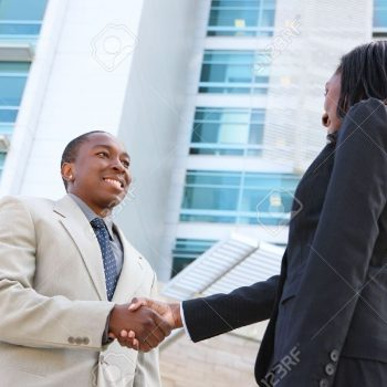 7049700-an-african-american-business-man-and-woman-team-handshake-at-office-building-stock-photo